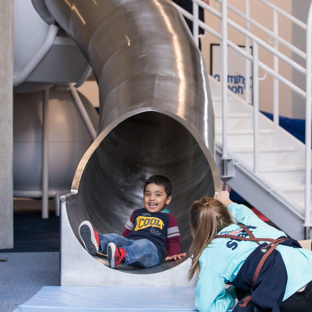Child sliding down the dream machine