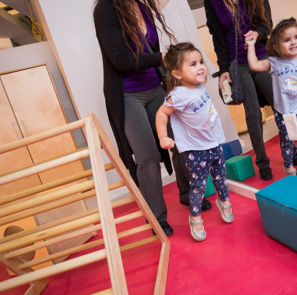 Little girl playing in little movers space
